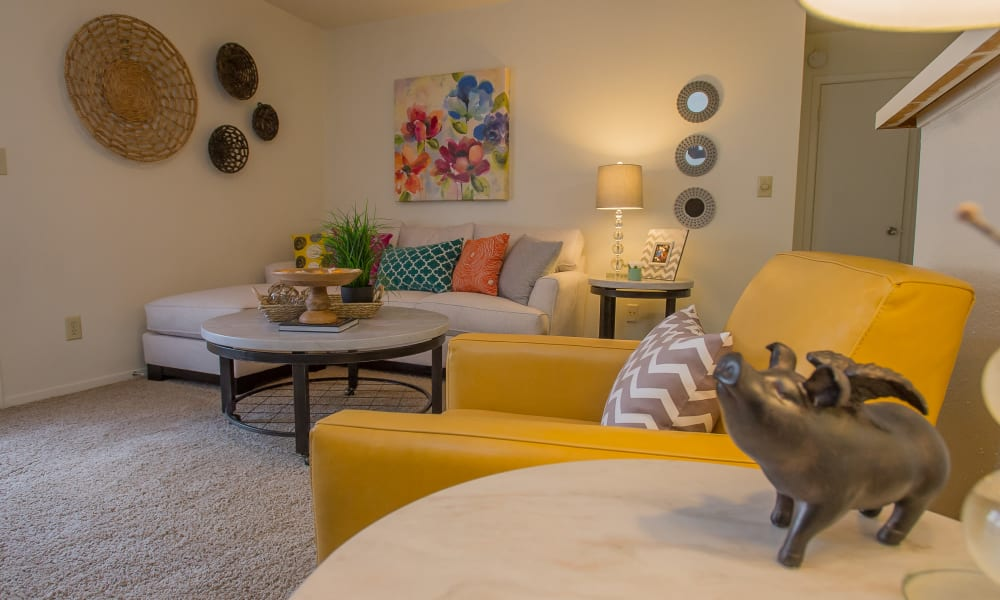 An apartment living room with furniture at Cimarron Trails Apartments in Norman, OK