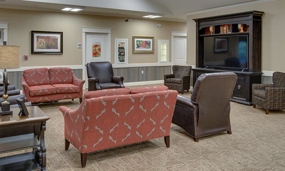 Entertainment room with comfortable seating at Mill Creek Village Senior Living in Columbia, Missouri