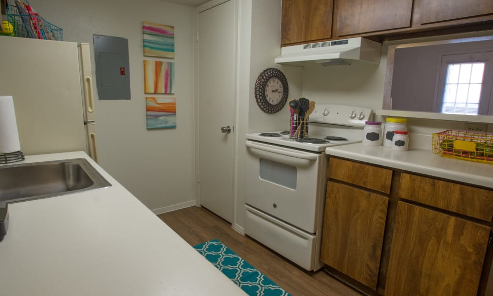 Fully equipped kitchen at Cimarron Trails Apartments in Norman, Oklahoma