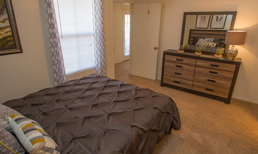 Bright bedroom at Cimarron Trails Apartments in Norman, Oklahoma