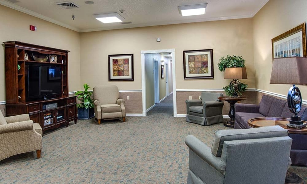 Entertainment room with comfortable seating at Lakewood Senior Living in Springfield, Missouri