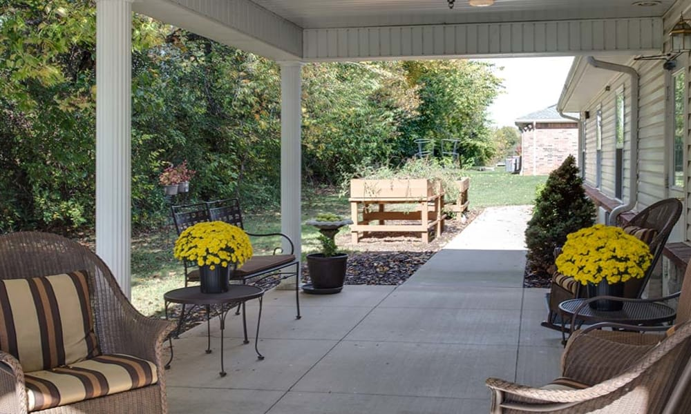Concrete walkway with outdoor seating at Lakewood Senior Living in Springfield, Missouri