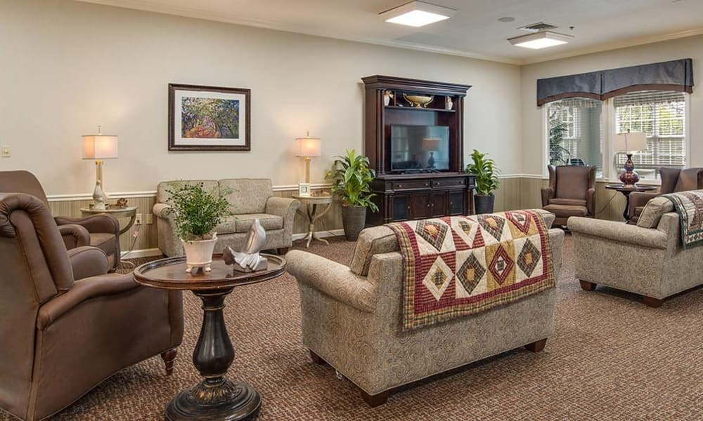 Community lounge with comfortable seating at Hickory Gardens in Madison, TN