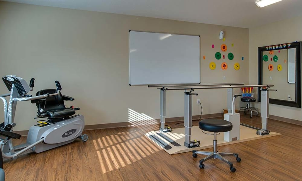 Rehabilitation gym with hardwood floors at Galena Nursing Center in Galena, Kansas