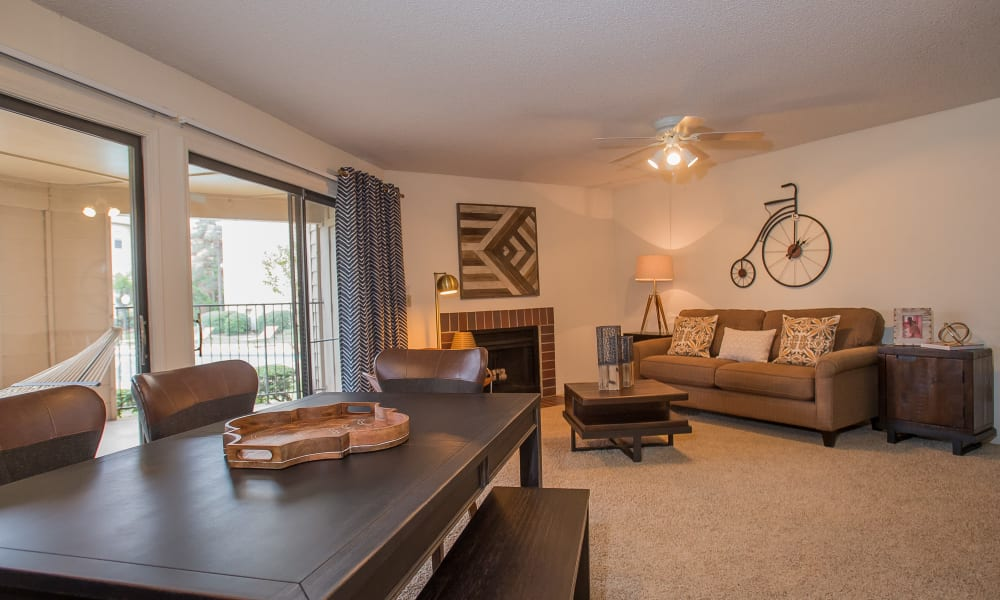 Dining area and living room at Copperfield Apartments in Oklahoma City, Oklahoma