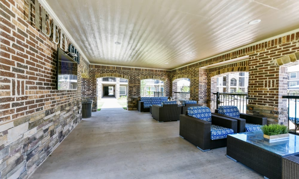 Outdoor seating area at Cottages at Abbey Glen Apartments in Lubbock, Texas