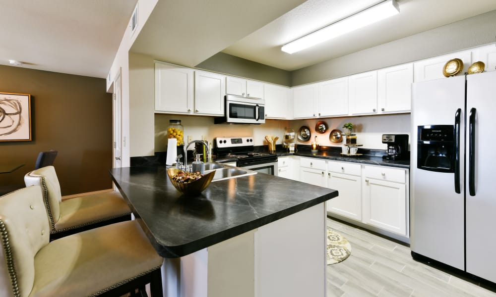 Fully equipped kitchen at Cottages at Abbey Glen Apartments in Lubbock, Texas