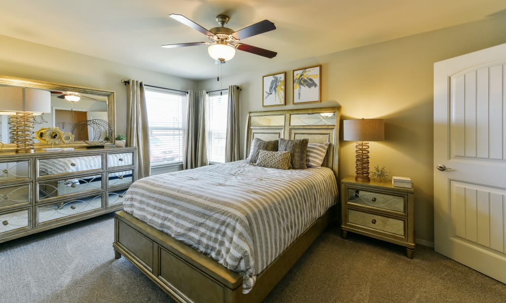 Cozy bedroom at Cottages at Abbey Glen Apartments in Lubbock, Texas