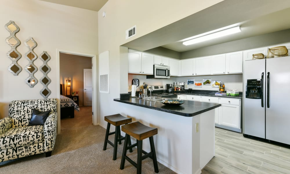 Kitchen with ample counter space at Cottages at Abbey Glen Apartments in Lubbock, Texas