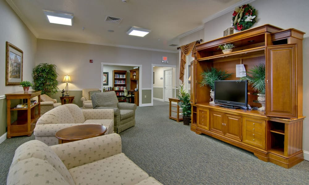 Entertainment room with comfortable seating at Foxberry Terrace Senior Living in Webb City, Missouri