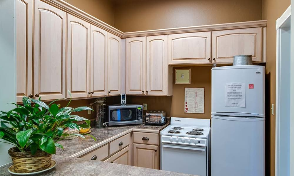 Community kitchen with accessible counters at Foxberry Terrace Senior Living in Webb City, Missouri