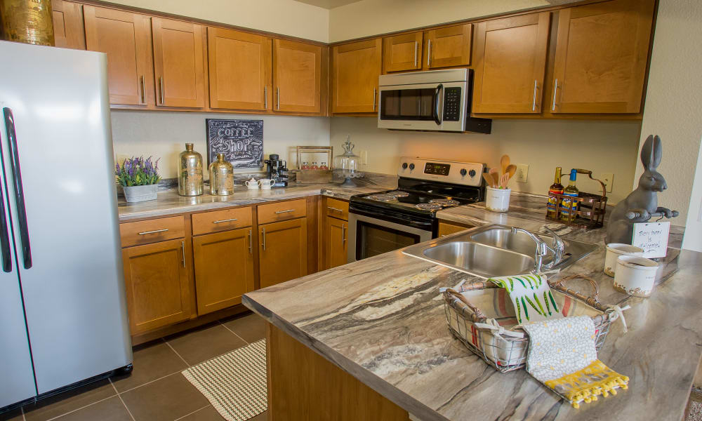 Kitchen with plenty of cabinet space at Icon at Norman in Norman, Oklahoma