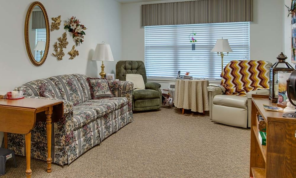Apartment living room at Carrington Place in Pittsburg, Kansas