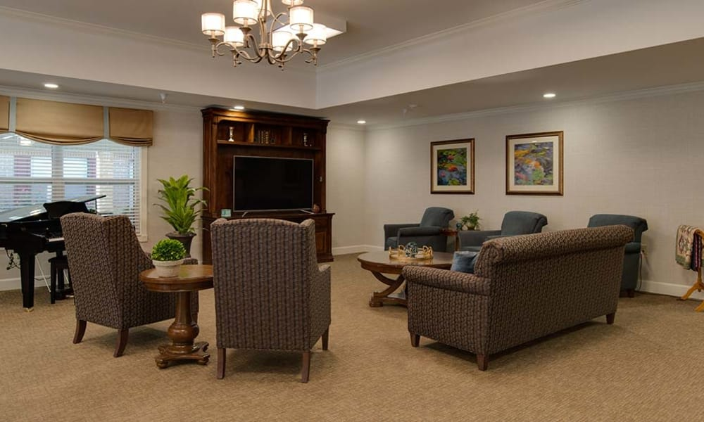 Entertainment room with comfortable seating at Carrington Place in Pittsburg, Kansas