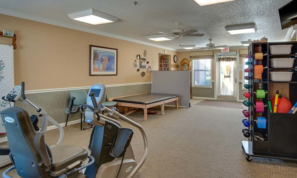 Assisted Living lounge with exercise equipment at Carrington Place in Pittsburg, Kansas