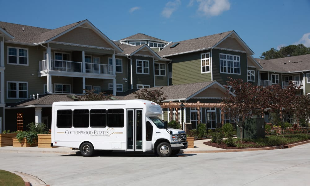 The community bus parked outside of Cottonwood Estates Gracious Retirement Living in Alpharetta, Georgia