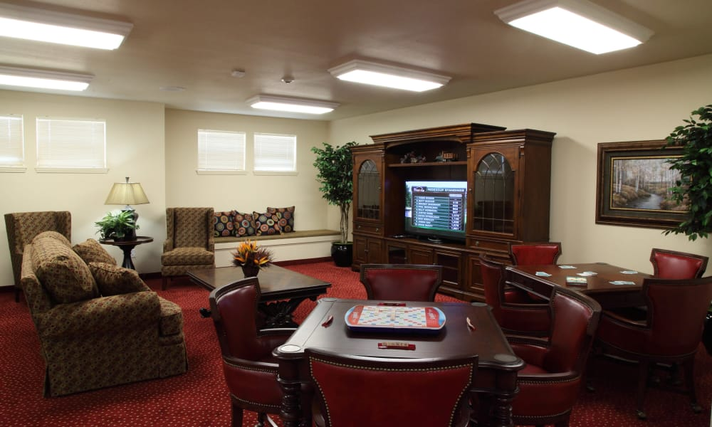 The game room with scrabble on the table at Cottonwood Estates Gracious Retirement Living in Alpharetta, Georgia