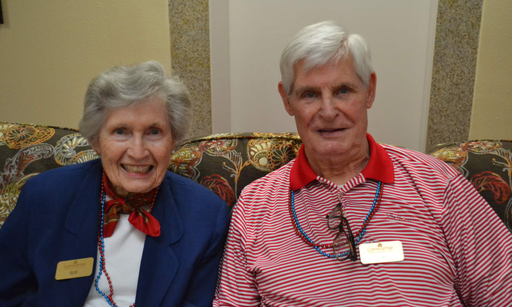 Two residents posing for a photo at Cypress Springs Gracious Retirement Living in Bradenton, Florida