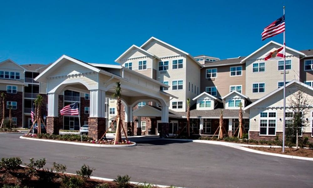 Building exterior and main entrance to Cypress Springs Gracious Retirement Living in Bradenton, Florida