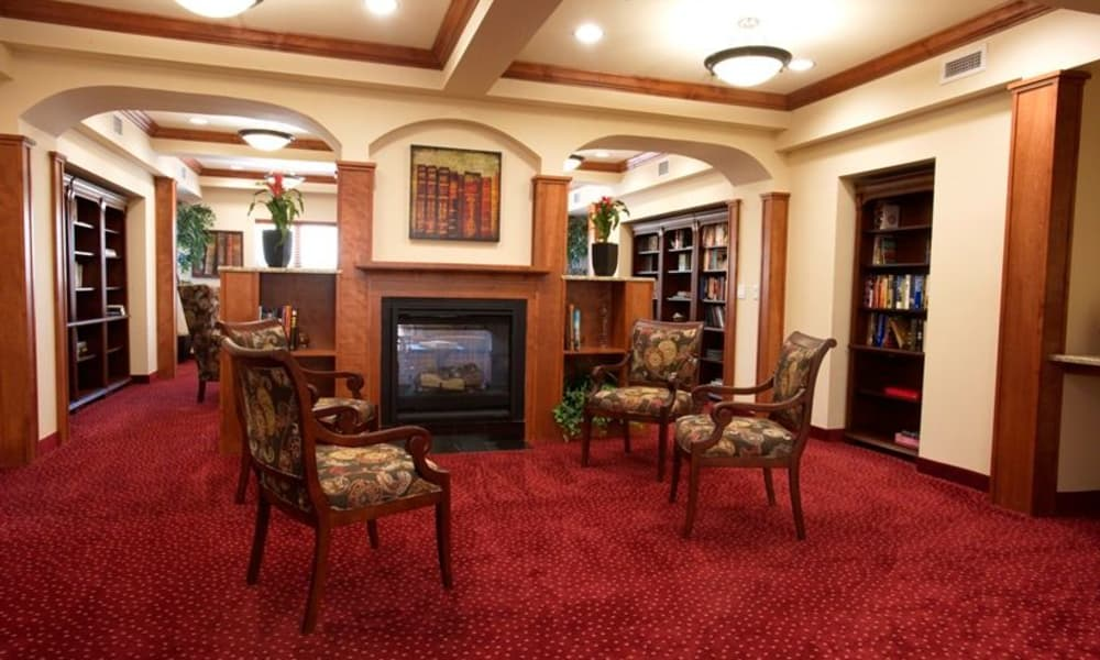 Fireside seating in the library at Cypress Springs Gracious Retirement Living in Bradenton, Florida