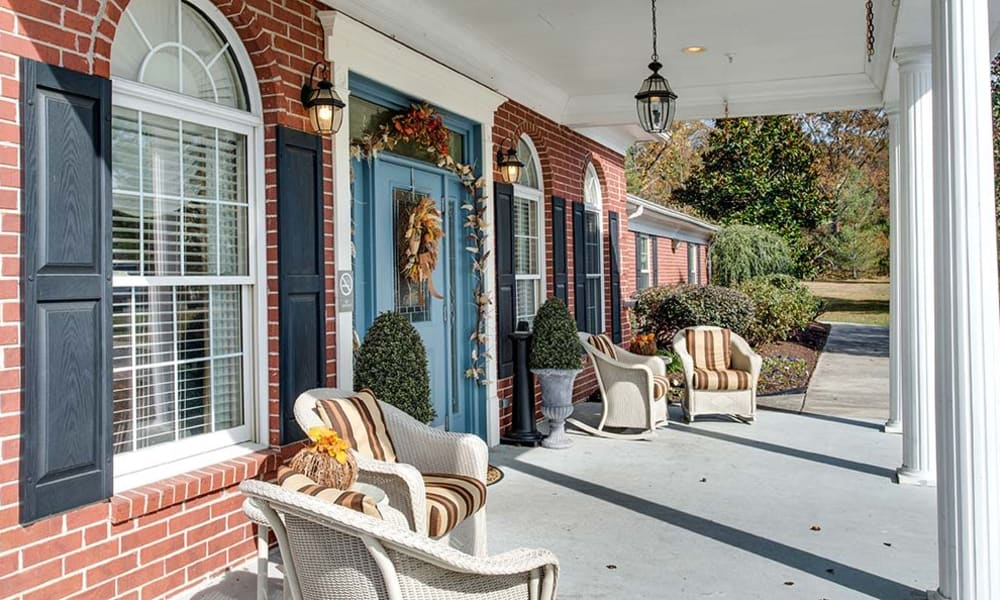 The front porch with covered seating at Autumn Oaks in Manchester, Tennessee