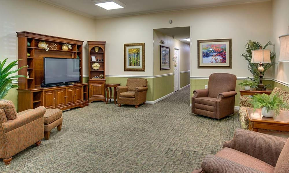 Entertainment room with comfortable seating at Auburn Creek Senior Living in Cape Girardeau, Missouri