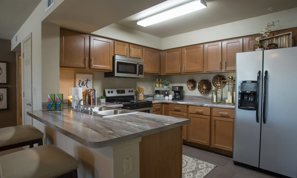 Fully equipped kitchen with granite counters at Tuscany Ranch in Waco, Texas