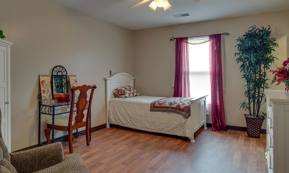 Bedroom with a view of the bathroom and kitchen at Victorian Place of Cuba Senior Living in Cuba, Missouri