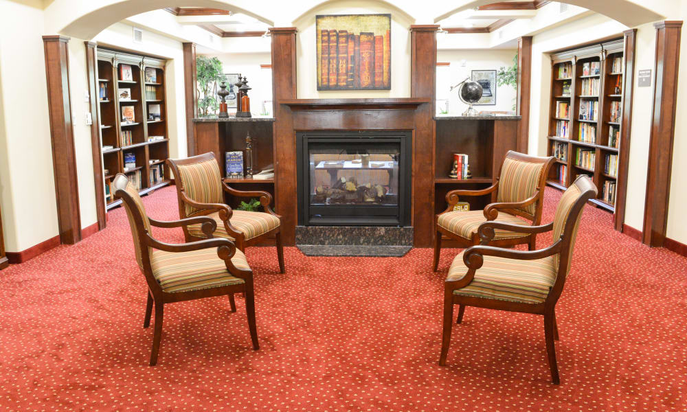 Fireside seating in the library at Desert Springs Gracious Retirement Living in Oro Valley, Arizona