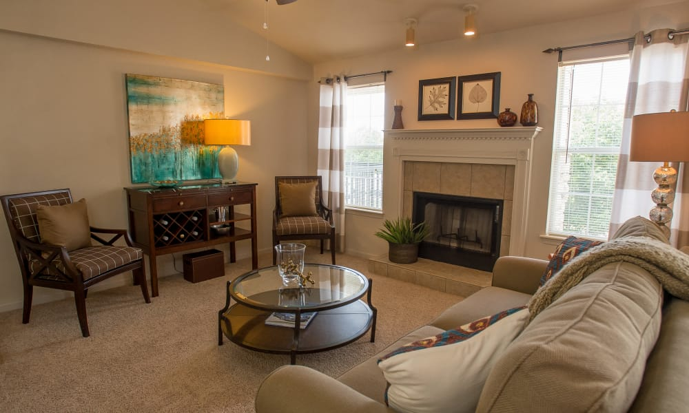 Carpeted living room with a fireplace at Villas at Stonebridge in Edmond, Oklahoma