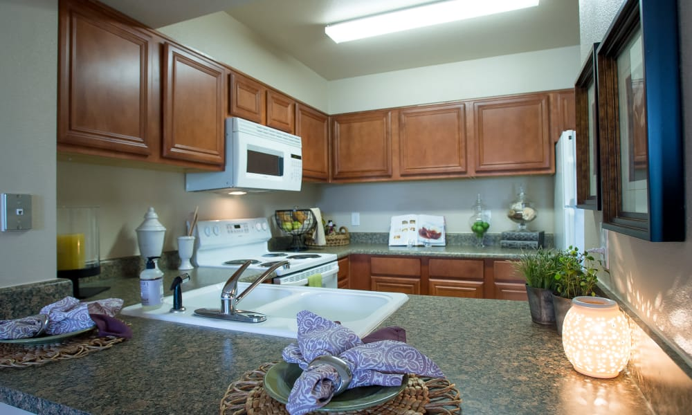 Kitchen with plenty of counter space at Villas at Stonebridge in Edmond, Oklahoma