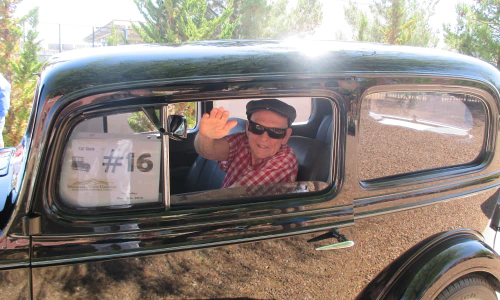 A resident from El Dorado Estates Gracious Retirement Living in El Dorado Hills, California in a classic car for a car show