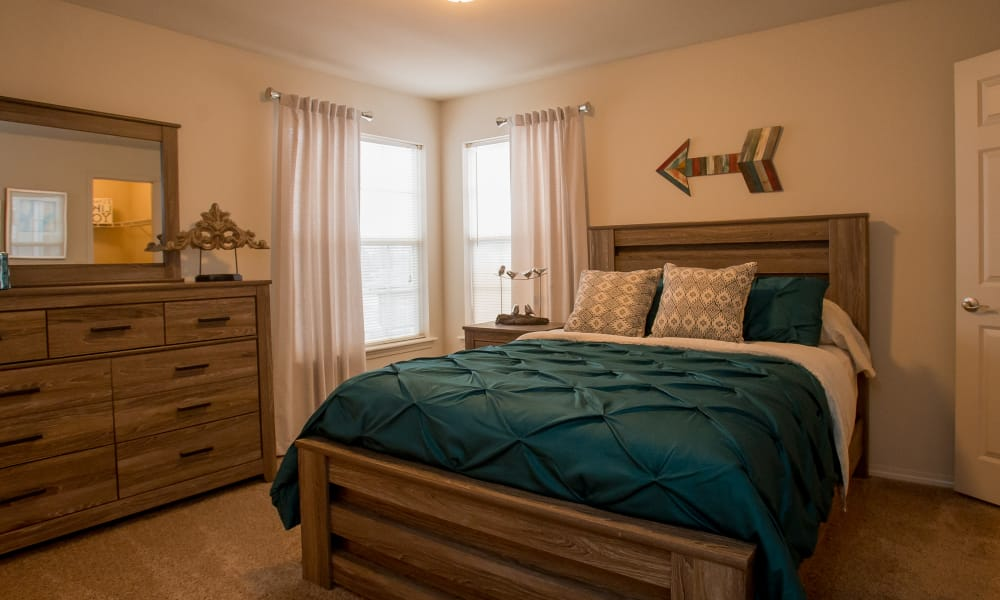 Large bedroom with a window at Villas of Waterford Apartments in Wichita, Kansas