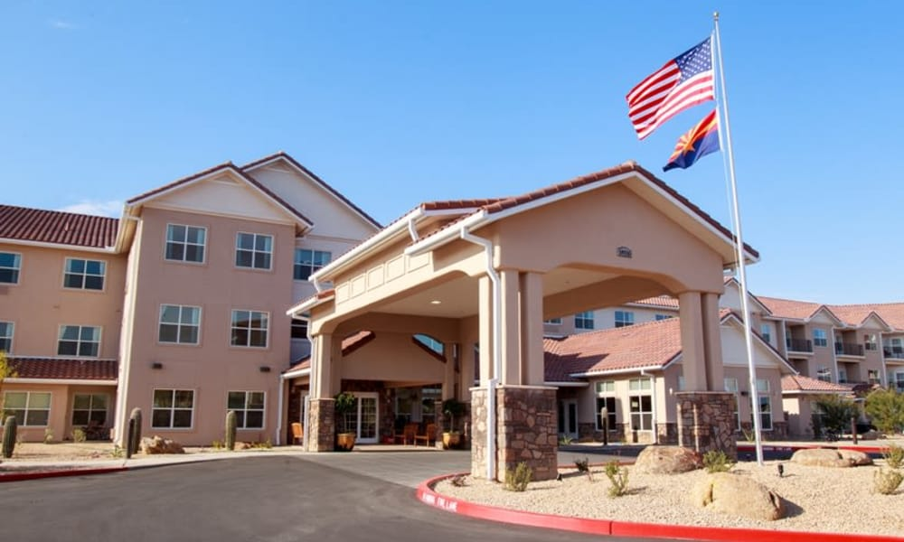 Building exterior and main entrance at Estrella Estates Gracious Retirement Living in Goodyear, Arizona
