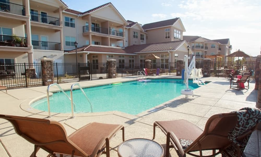 Community swimming pool for residents at Estrella Estates Gracious Retirement Living in Goodyear, Arizona