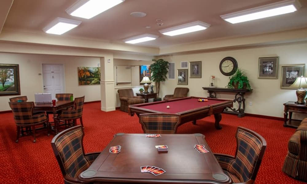 Billiards table and Uno card game in the game room at Estrella Estates Gracious Retirement Living in Goodyear, Arizona
