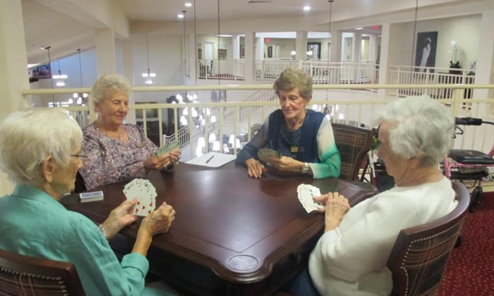 A group of residents playing a game of cards at Fairview Estates Gracious Retirement Living in Hopkinton, Massachusetts