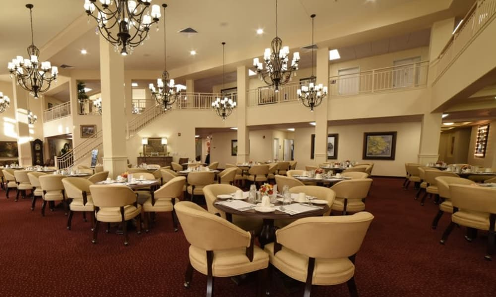 Large community dining room for residents at Fairview Estates Gracious Retirement Living in Hopkinton, Massachusetts