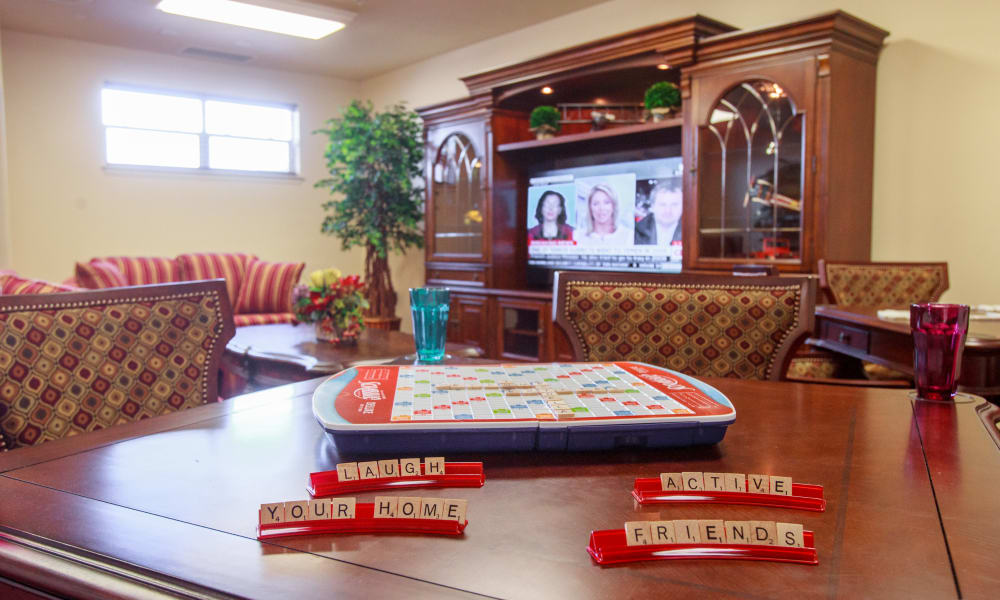 Scrabble on a table in the game room at Fairview Estates Gracious Retirement Living in Hopkinton, Massachusetts