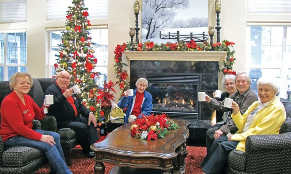 A group of residents pose for a holiday photo at Glenmoore Gracious Retirement Living in Happy Valley, Oregon