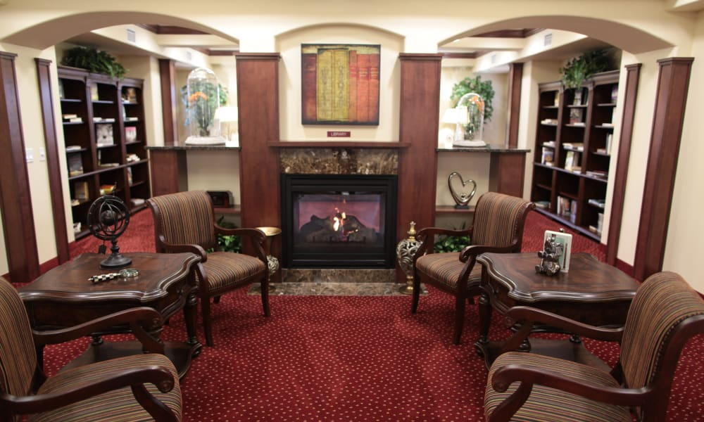 Fireside seating in the library at Glenmoore Gracious Retirement Living in Happy Valley, Oregon