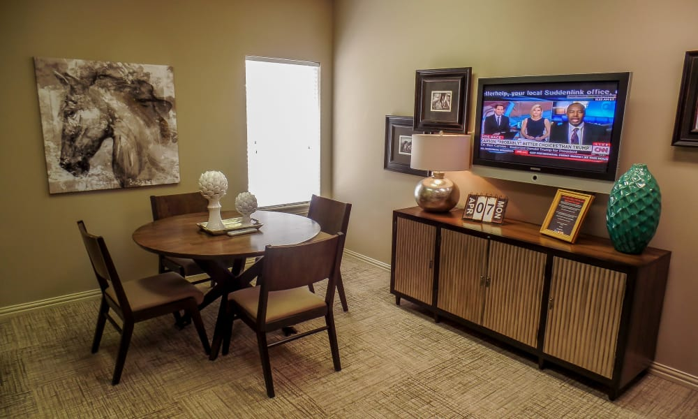 Dining room with a TV at Winchester Apartments in Amarillo, Texas