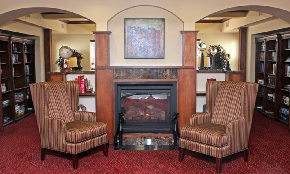 Fireside seating in the library at Heatherwood Gracious Retirement Living in Tewksbury, Massachusetts