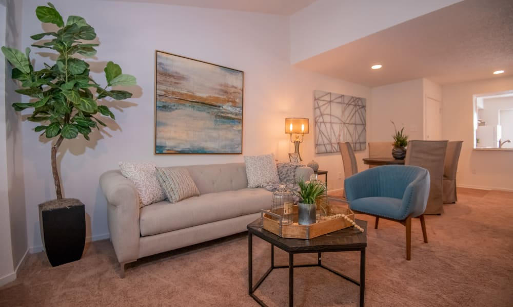 An apartment living room with couch and table at The Trace of Ridgeland in Ridgeland, MS