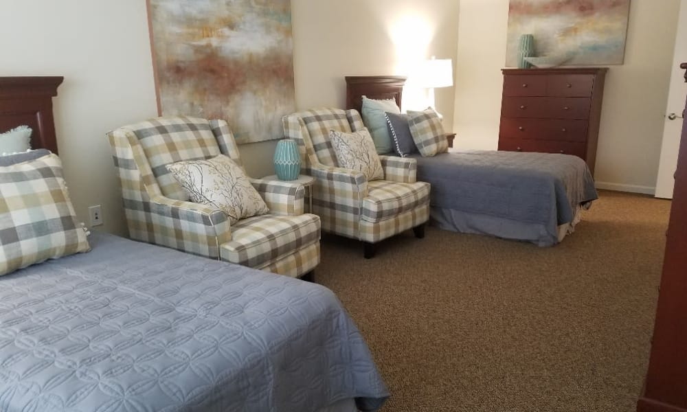 Duo living space with beds at The Arbors at Harmony Gardens in Warrensburg, Missouri