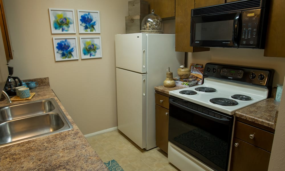 Well equipped kitchen at Barcelona Apartments in Tulsa, Oklahoma