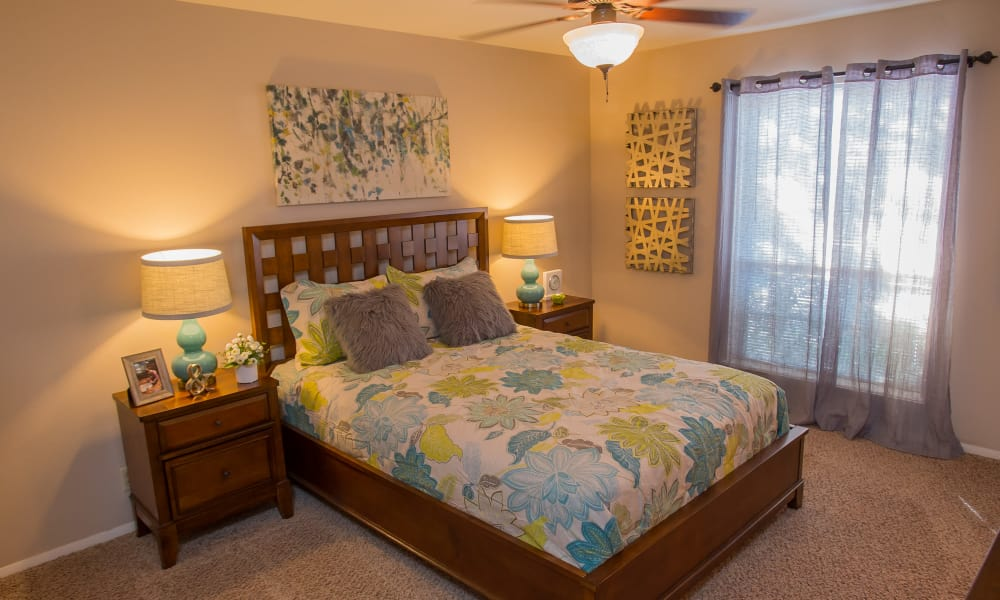 Well-lit bedroom at Barcelona Apartments in Tulsa, Oklahoma