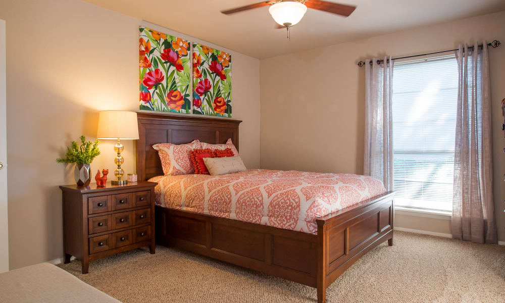 Well decorated bedroom at Barcelona Apartments in Tulsa, Oklahoma