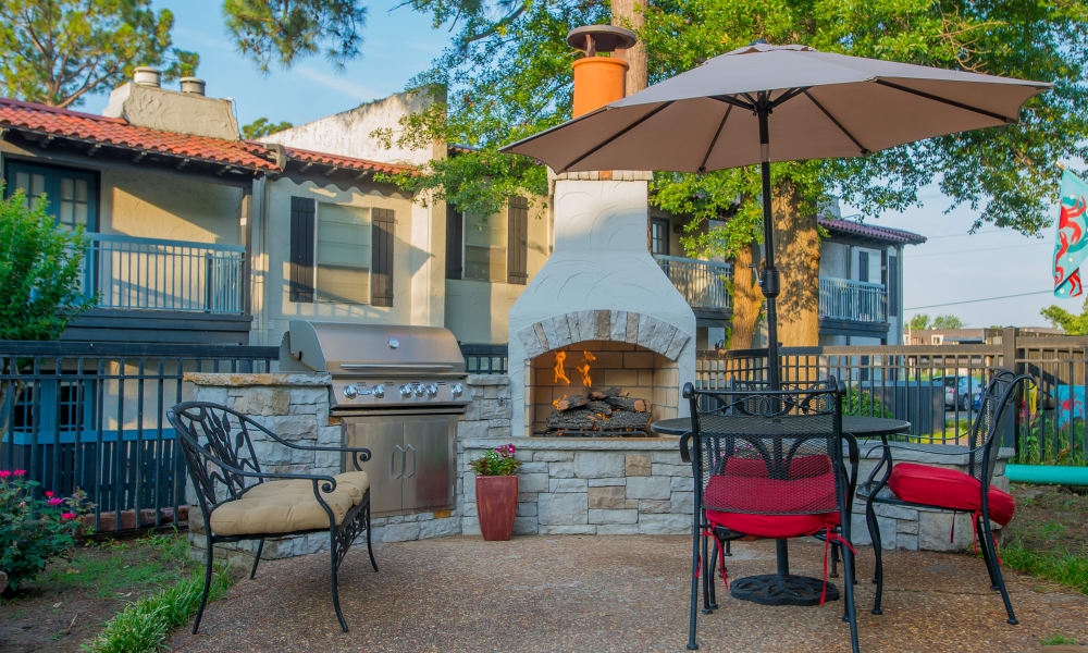 An outdoor fireplace at Barcelona Apartments in Tulsa, OK