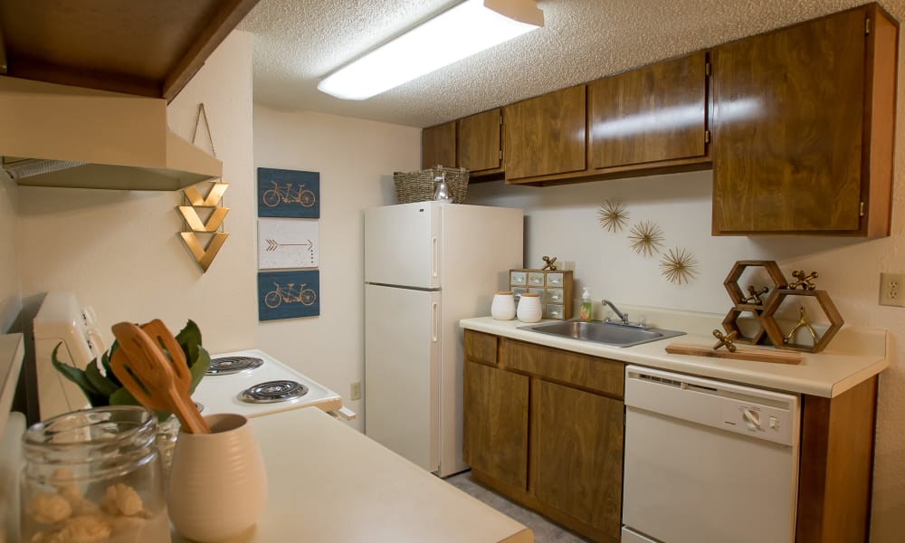Well equipped kitchen at Cimarron Pointe Apartments in Oklahoma City, Oklahoma